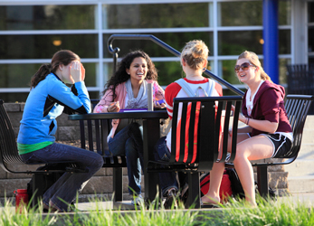 Four students gather on campus